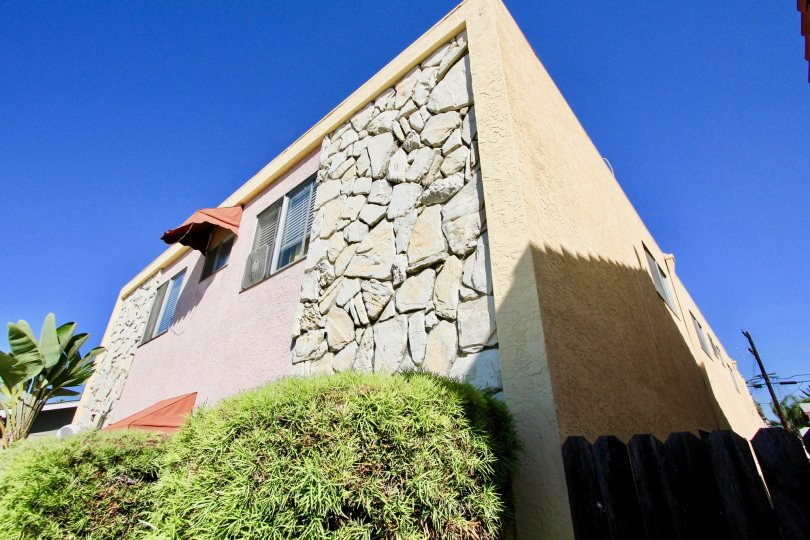 Stone walls of 33rd Street Manor is the distinction of her building. Only in Normal Heights, California