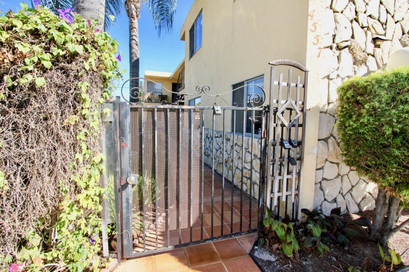 The closed gate of the side entrance for the house on 33rd Street Manor.