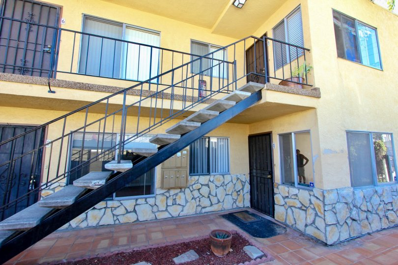 A stairs of a yellow apartment complex in 33rd Street Manor community