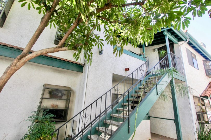 The green staircase leading upto apartments in 34th Street Villas in California.