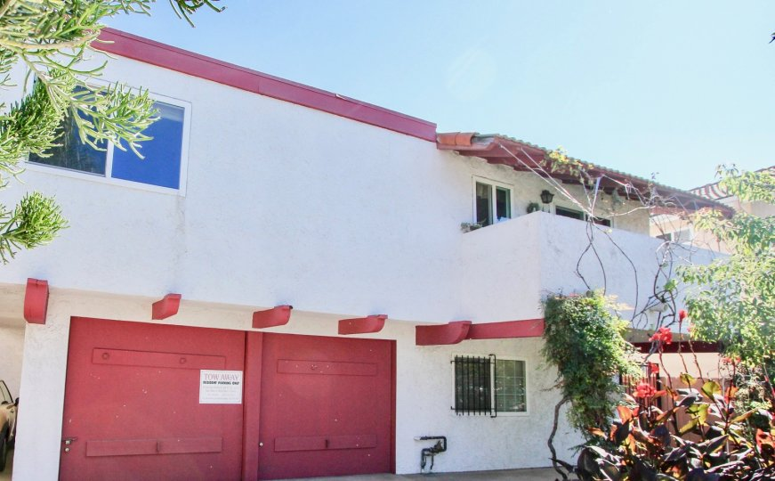 Sunny day garage door front view of 4753 35 St community building, Normal Heights, CA