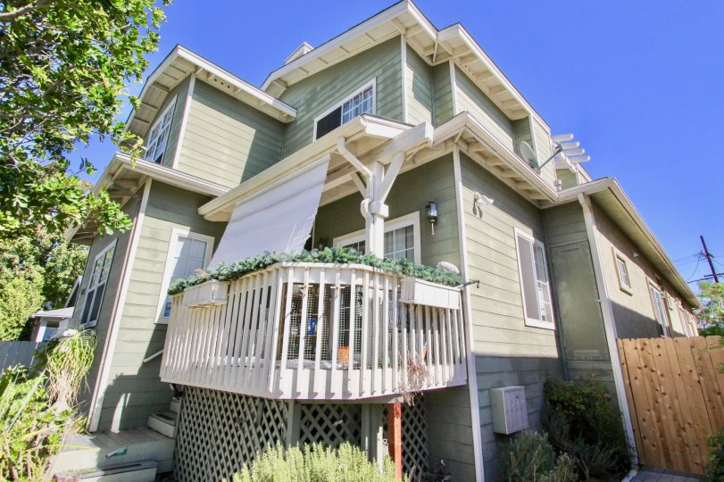 Two story gray home with a white patio located at 4755 Wilson in Normal Heights CA