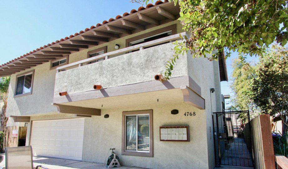 A two-storey residence with an exposed eave and balcony in 4768 35th St neighborhood.