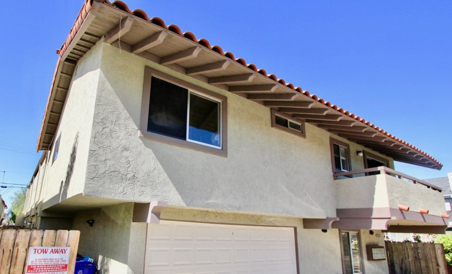 A sunny day in the area of 4768 35th st, outside, garage, wooden fence, condos, balcony