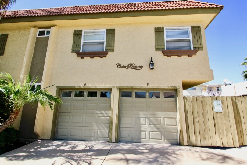 Two garage doors sit below units at the Casa Blanca Villas community of Normal Heights, California.