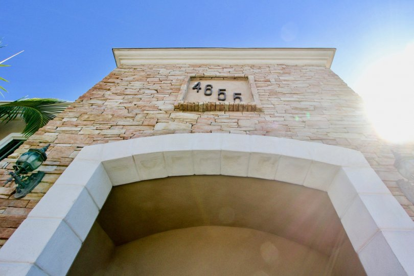 Stunning archway with decorative address plaque and light sconces at Casa Bonita