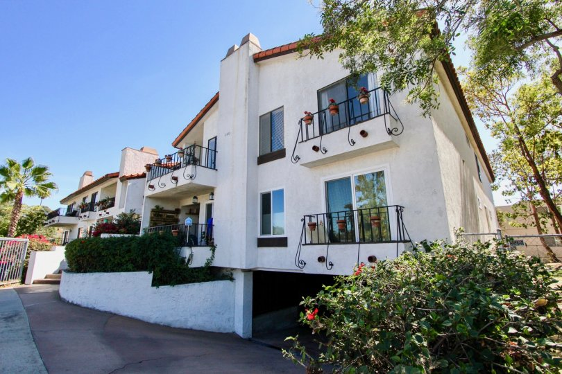 A beautiful building with flowers and trees in casa Monterey of normal heights