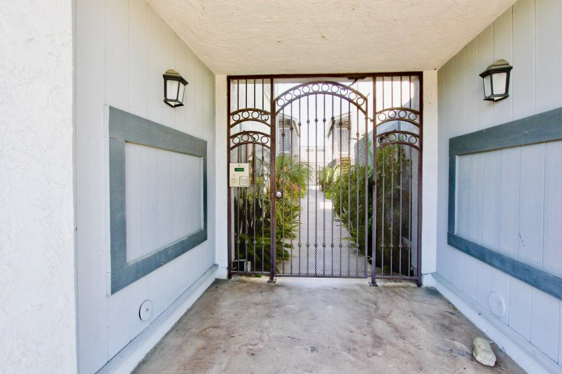 An entrance place with a grilled gate with lights in a villa in Cherokee Court of Normal Heights