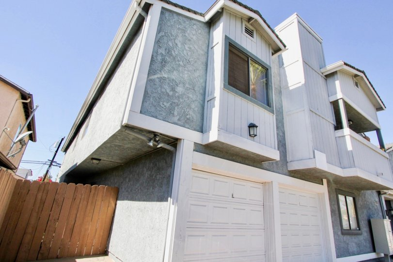 Cherokee Court white building with 2 garage in Normal Heights California