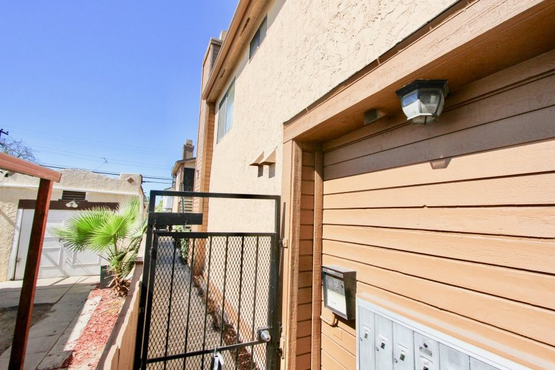A sunny day in the area of Deone Manor, outside, garage, gated entrance, light, walkway, stairs, condo