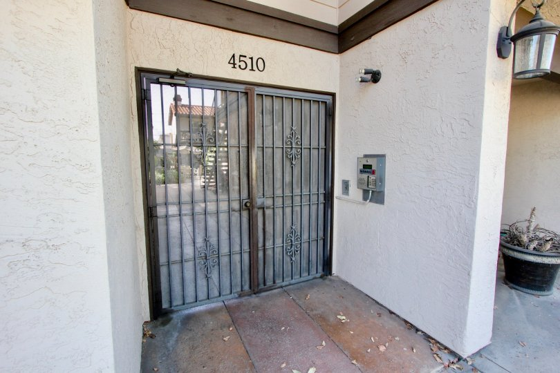 A security door locks the entrance of the Garden Heights community in Normal Heights, California.