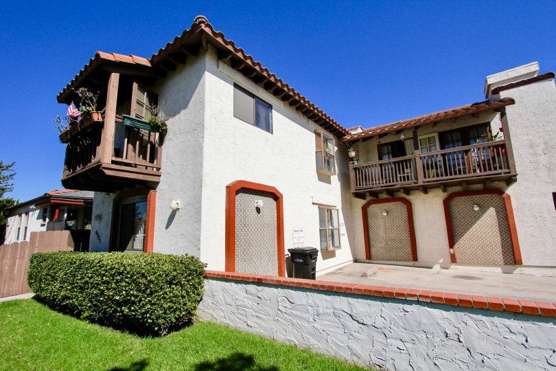 A sunny day in the area of Hawley Villas, outside, bush, brick, driveway, garage, balcony