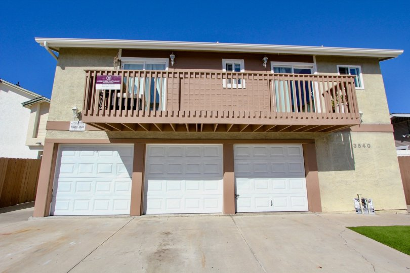 A balcony and garage doors on a home at Madison Gardens in Normal Heights California.