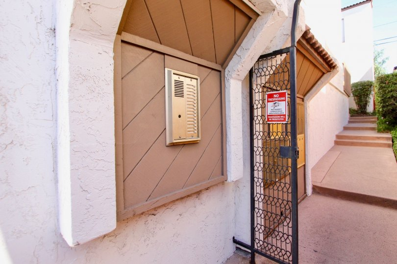 Entrance to Mission Villas with metal gate and call box to apartments in Normal Heights, Ca.