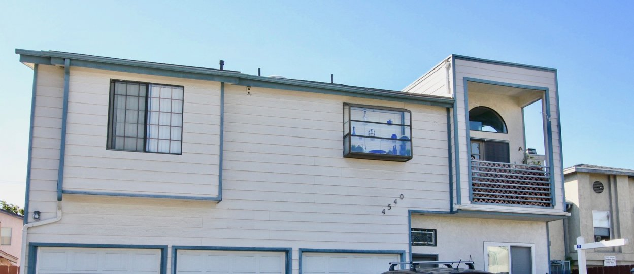 A sunny day in the area of North Court, balcony, windows, roof, garages, sign