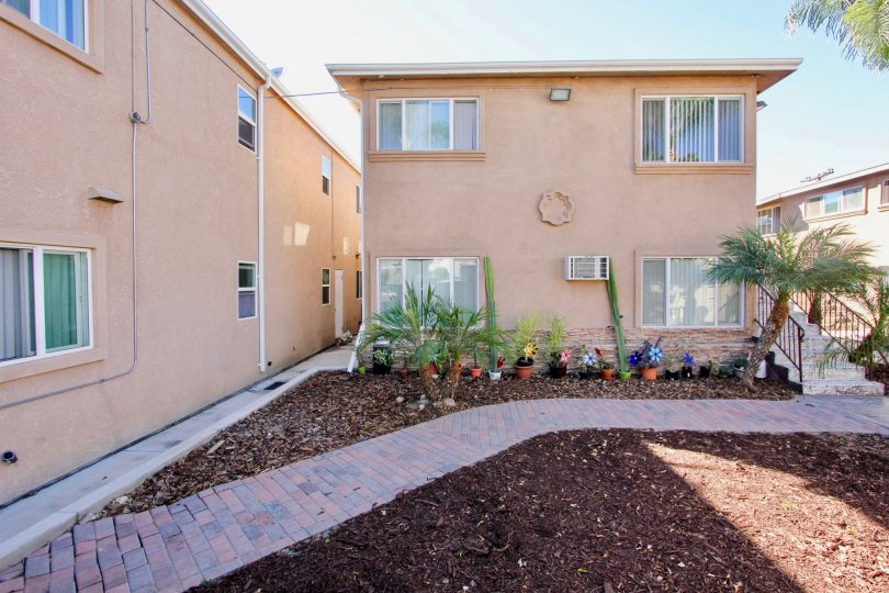 A sunny day in the Palm Terrace community Normal Heights, CA showing rear dwelling and potted plants