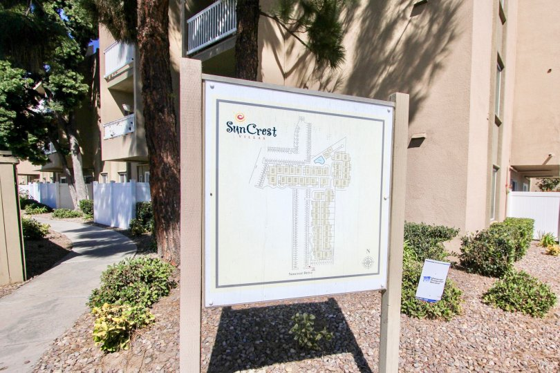 The exterior of Suncrest Villa and the sign of housing in Normal heights