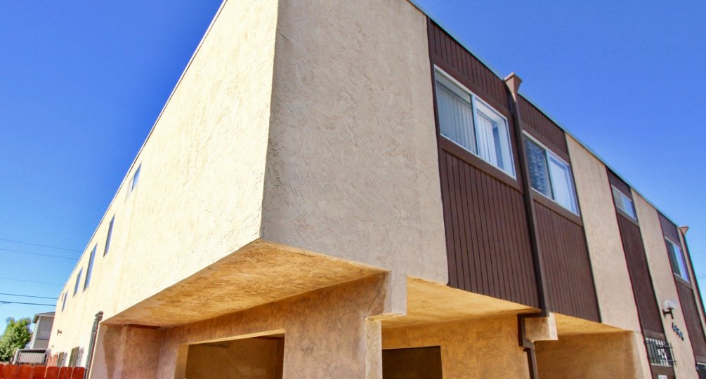 A two story cement and wood town home building in Normal Heights CA at Teralta Heights