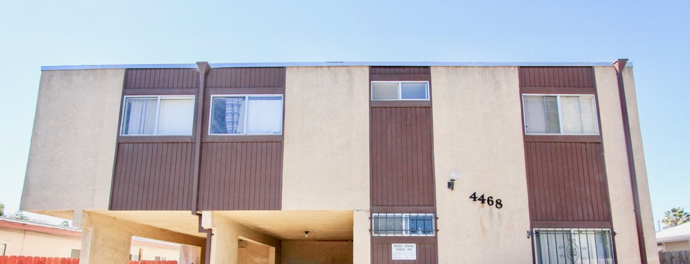 A sunny day in the area of Teralta Heights, car port, windows, condos, outside