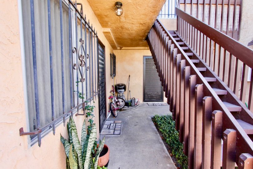 THE ESTATE IN THE TERALTA HEIGHTS WITH THE UPSTAIRS, BICYCLE, FLOWER POT, PLANTS