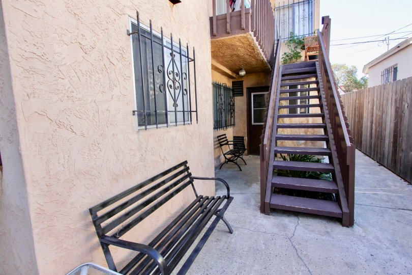 A sunny day in the area of Teralta Heights, outside, bench, stairs, wooden fencem windows, door