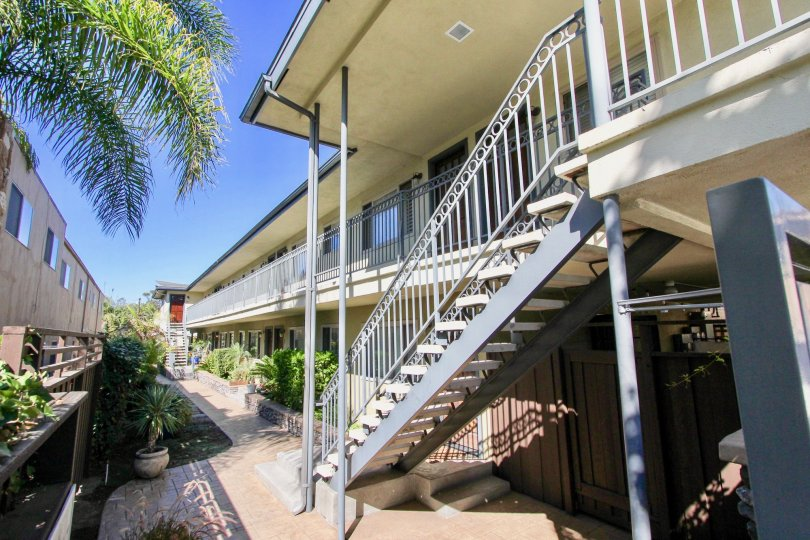Outdoor stairs and balcony of an apartment complex in the West Mountain View Condos area of Normal Heights, California