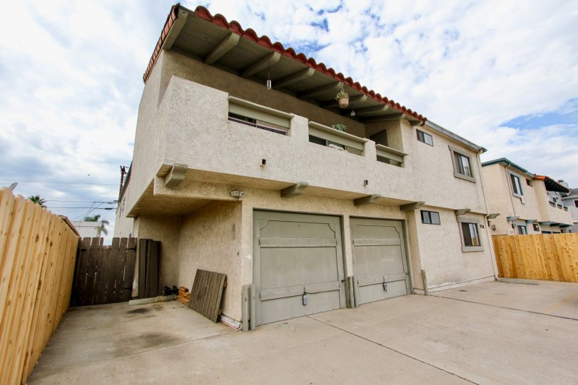 A two story home with a two car garage and a balcony on the second floor in the 33rd Street Vistas community of North Park, California