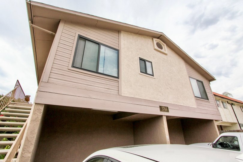 A sunny day in the area of 3766 31st Street, condos, stairs, card, parking area