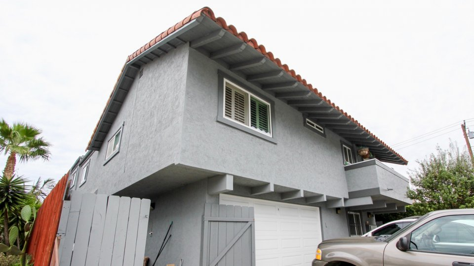 3788 Grim Ave community North Park California grey two story fence garage balcony tile roof palm tree landscaping