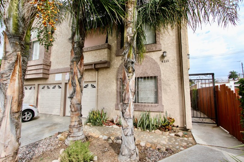 Multiple story housing with garages at 4111 Iowa St in North Park California