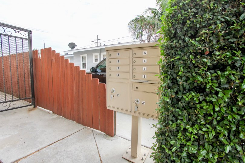 Wooden fencing with letter boxes and greens in 4111 Iowa St.