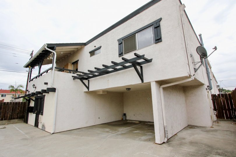 big car porch with contemporary styling house with wood seperating boundary wall of 4185 Louisiana St of North park, CA