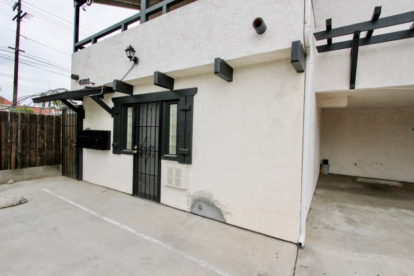 A sunny day in the area of 4185 Louisiana Street, condo, gated door, parking area