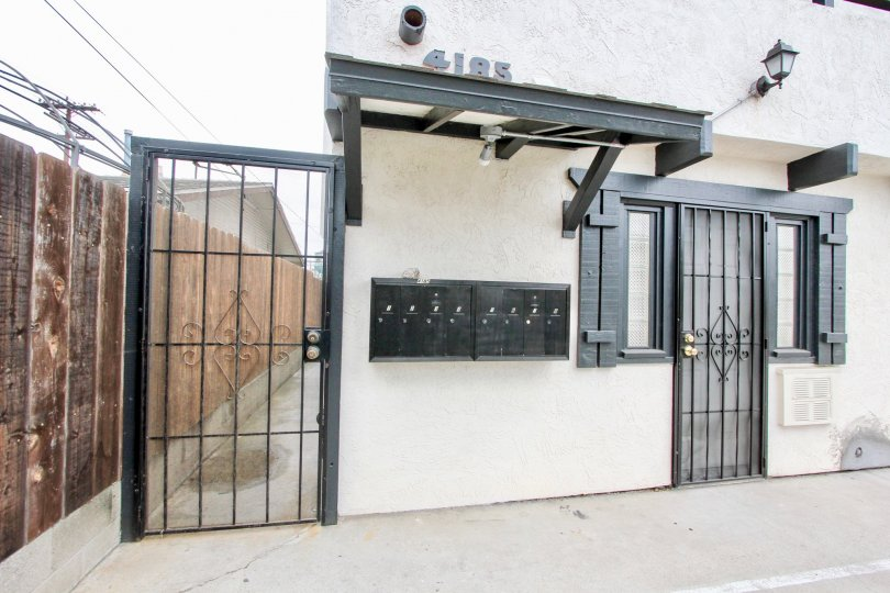 A sunny day in the area of 4185 Louisiana St, gated entrance, door, mailbox, light