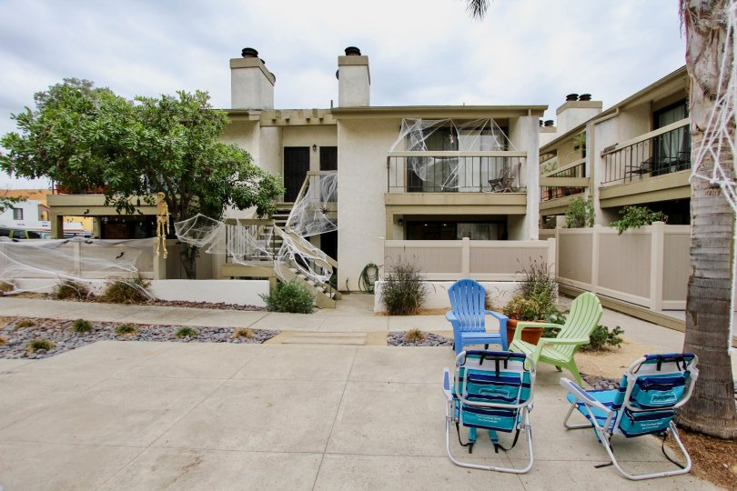 This low rise apartment complex is located in Alabama 12 community, in North Park, California. There seems to be four units per building, and each unit has a balcony or outdoor terrace if on the ground floor. There is a shared common space with seating an