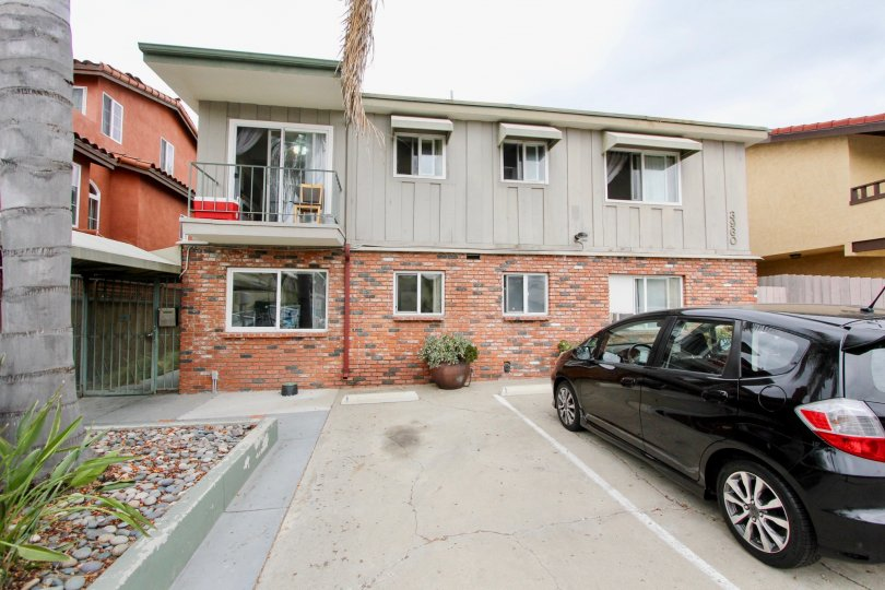 This is an exterior shot of an apartment building in the Arizona Estates Community in North Park, CA.