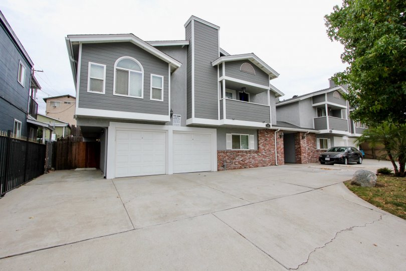 Housing with attached garages and a driveway at Arizon Gardens in North Park California