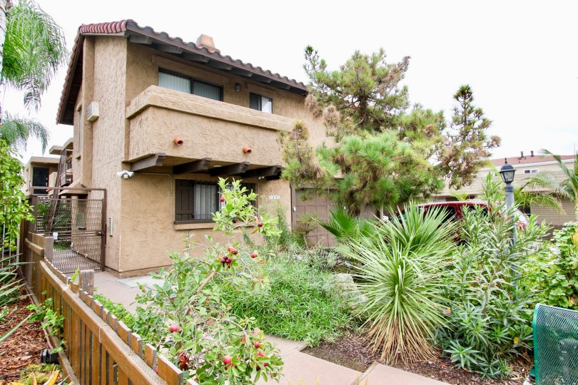 Barcelona Villa community North Park California landscaping balcony fence windows adobe southwestern style apartments trees