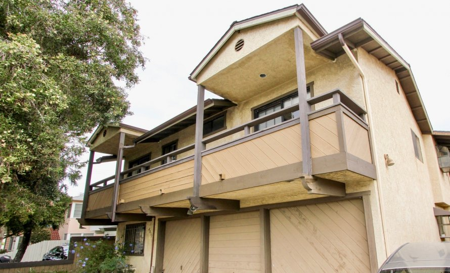 Two story residential building with attached garages at Birchmore in North Park California