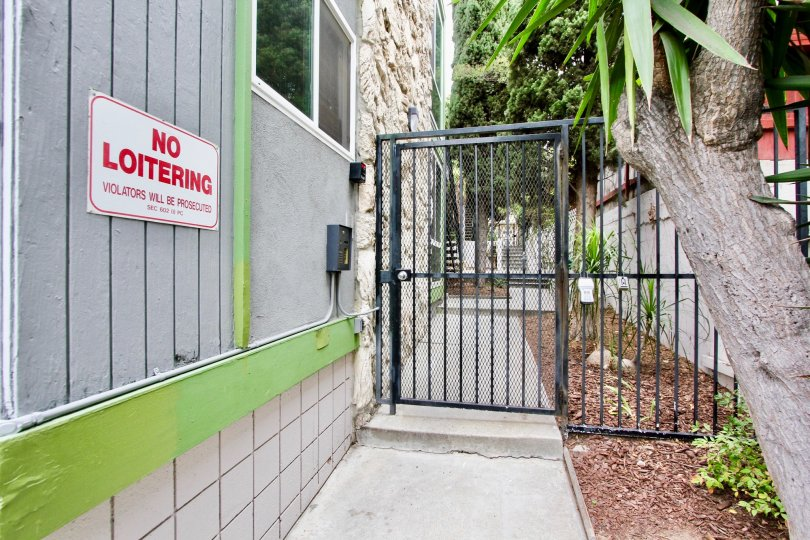 Security gate entrance next to building at Casa Riviera in North Park California