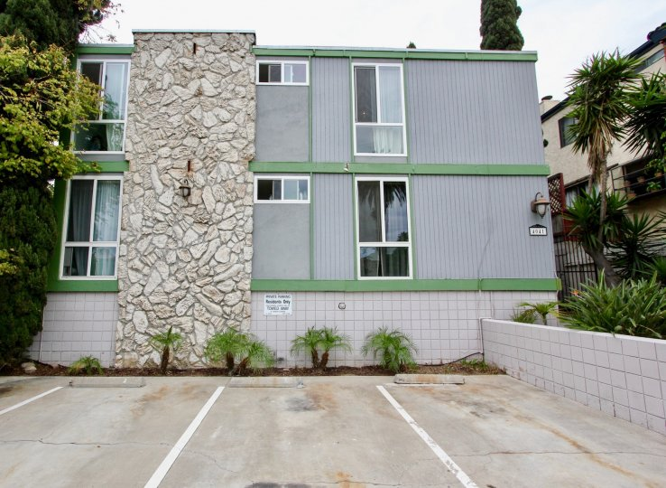 Three story housing next to parking spaces at Casa Riviera in North Park California