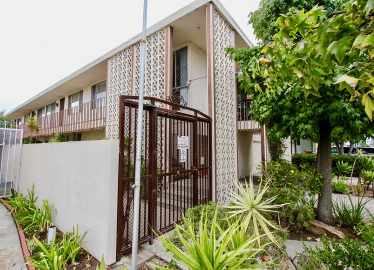 A sunny day in the area of Golden Oaks, condo, gated entrance, tree,