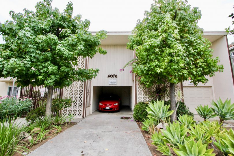 Car parking at the center of the house with plain elevation in Golden Oaks.