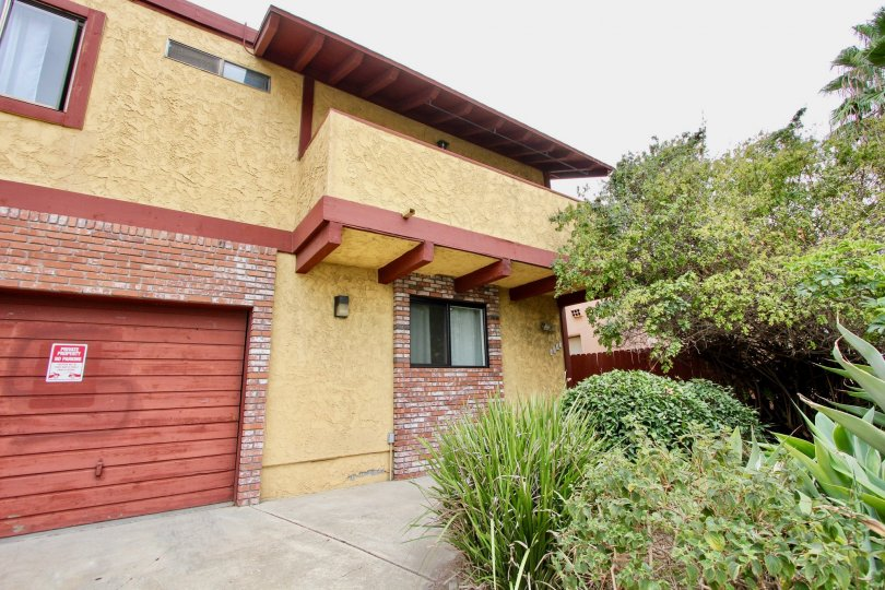 Red wood garage door with red bricks inside Hamilton Chateau in North Park CA