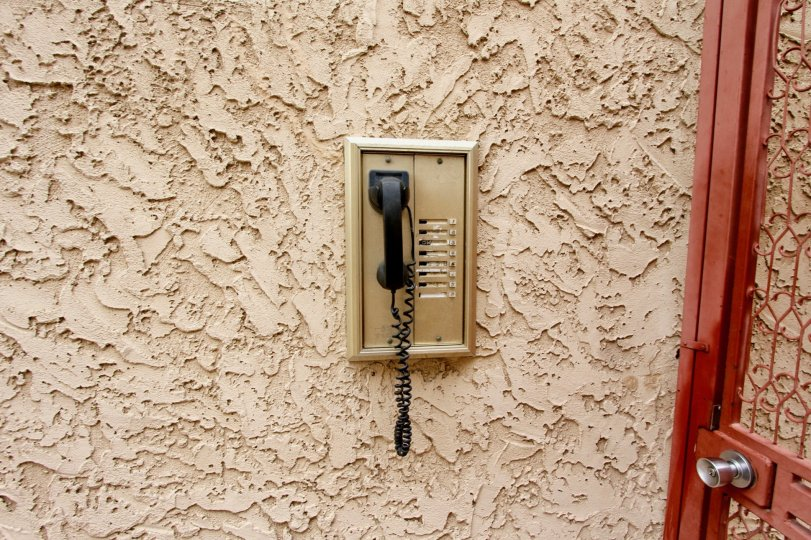 Textured wall with telephone in Illinois Park Condos North Park California.