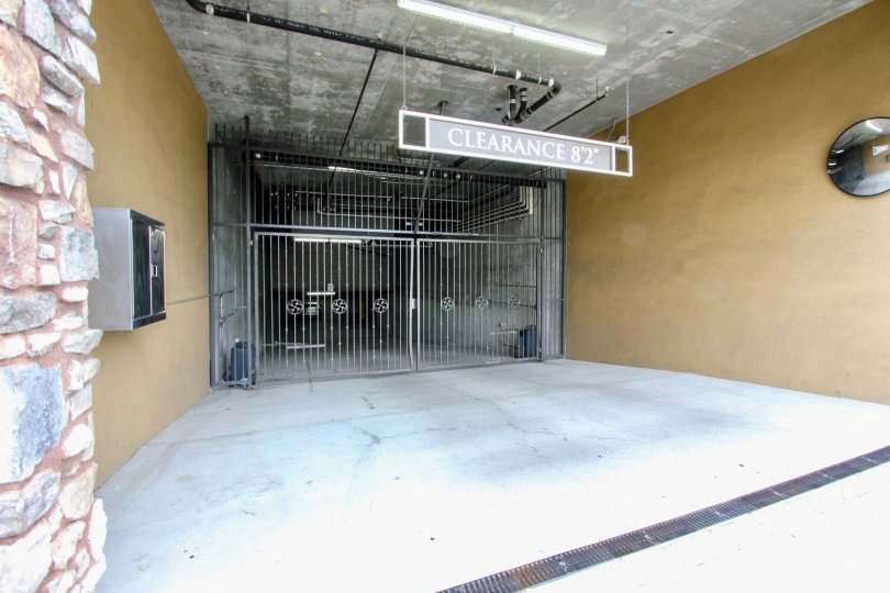 Parking garage entrance gate at a La Boheme community residence