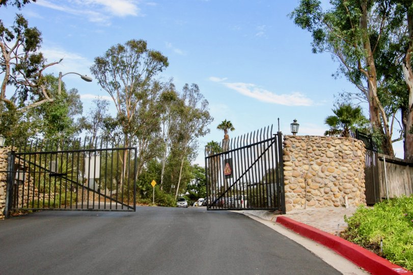 Front gate view with bright sky, La Hacienda, North Park, California