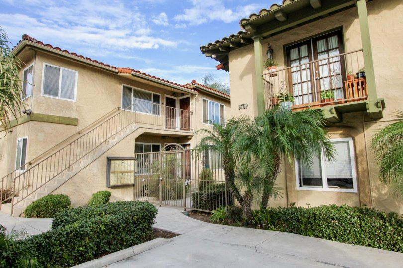 A pleasant day at La Hacienda park with secured gate and stairs to upstairs with many windows