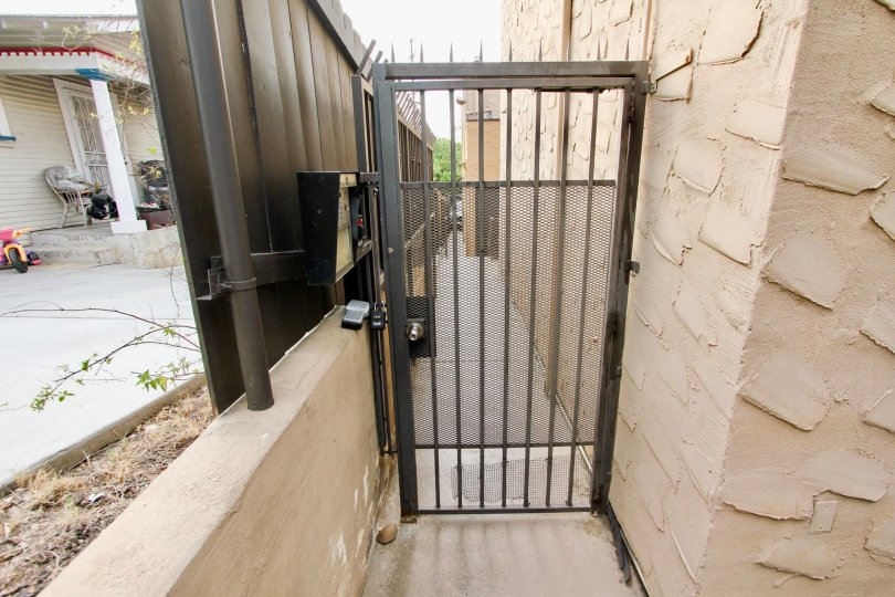 A metal gate secures this residence located in the Las Casitas community