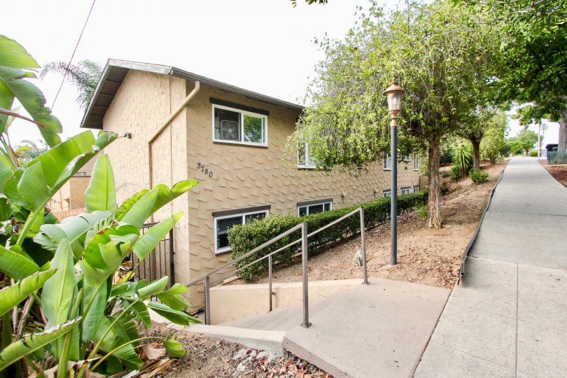 the sidewalk and entry stairway to an apartment complex in the Las Casitas neighborhood of North Park, CA